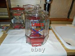 1930's Vintage 12 Lance Jar With Red Metal Stand And Over The Lip Glass LID