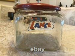 Vintage Glass Lance Cracker Jar Store Display with original red lid